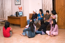 factory workers watching tv